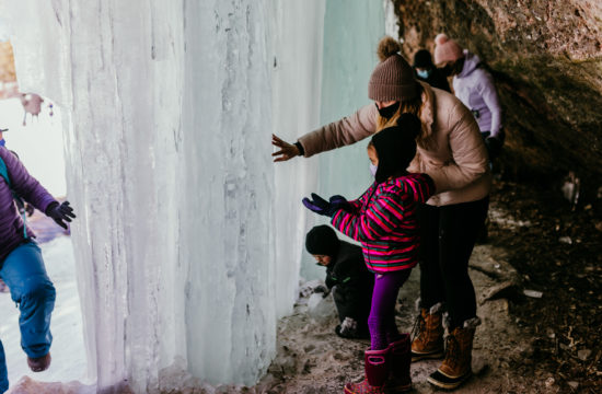 Mom and daughter exploring an ice cave